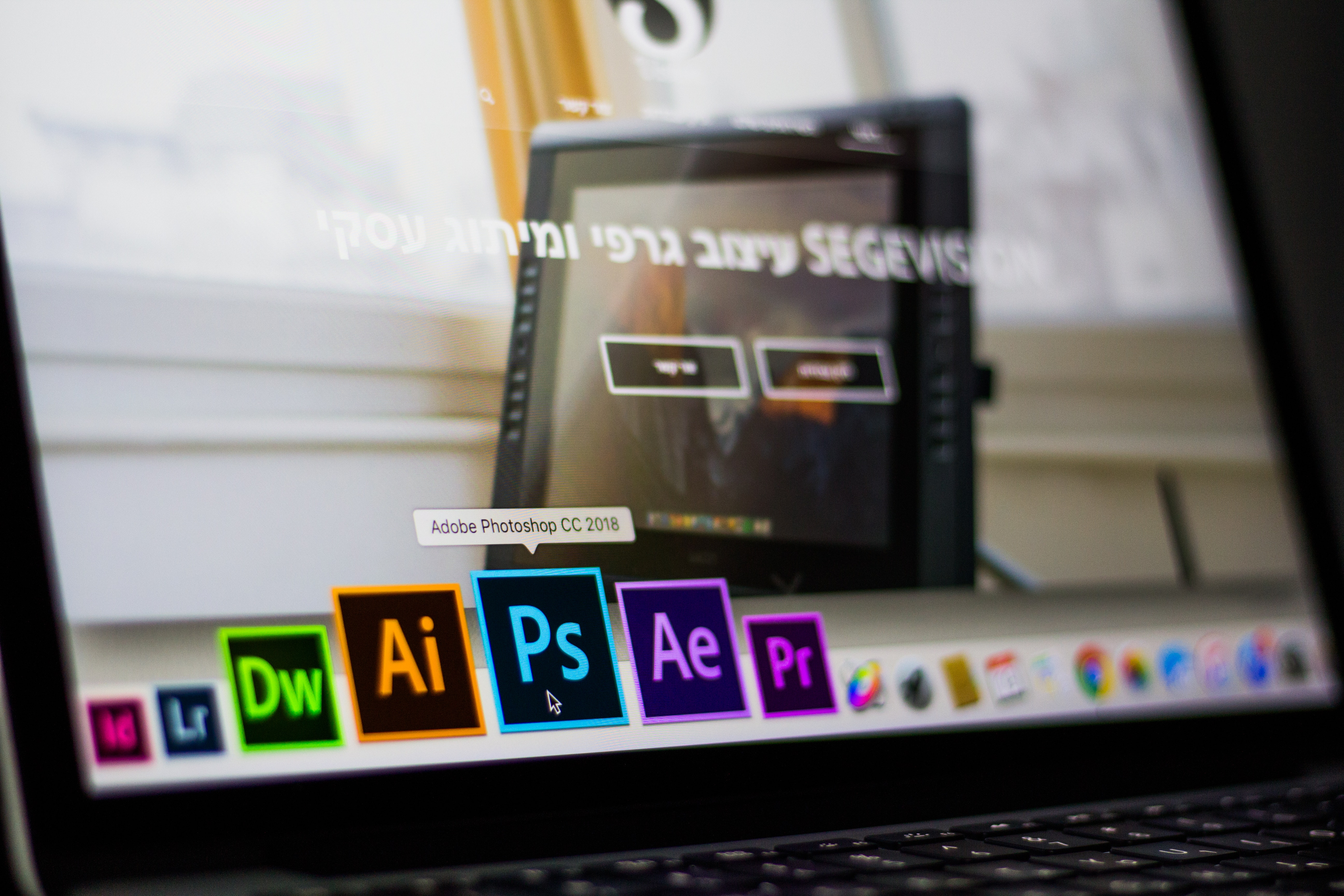 turned-on-laptop-on-desktop-with-hovered-adobe-photoshop-cc-693892